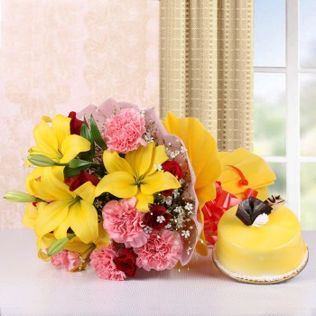 5 Yellow Asiatic Lilies and 8 Red Roses and 8 Pink Carnations in Pink and Yellow Paper with Mango Cake (Half Kg)