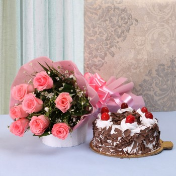 8 Pink Roses in Pink paper packing with Half Kg Black Forest Cake