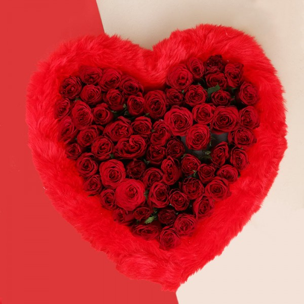 Heart-shaped Arrangement of 50 Red Roses, surrounded by Red Fur