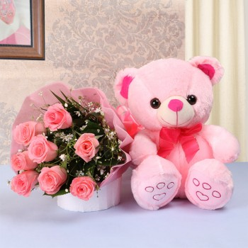 8 Pink Roses in Pink paper packing with 1 Pink Teddy Bear (10 inches)