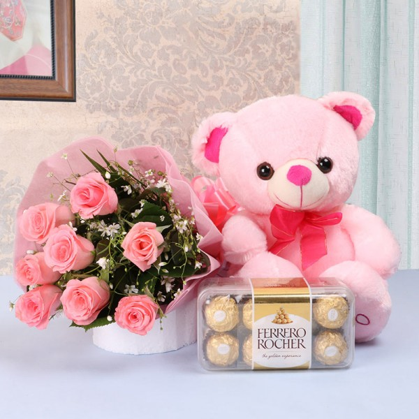 8 Pink Roses in Pink paper packing with 1 Pink Teddy Bear (10 inches) and Ferrero Rocher Chocolates (16 pcs)