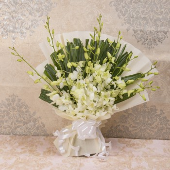 6 White Orchids in White paper packing