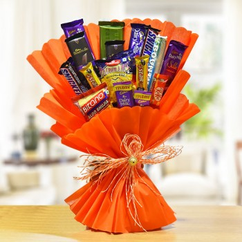 Bouquet of Chocolate and Wafers (Snacks Bouquet consisting of - 1 Bikano's Aloo Bhujia (40 gms) - 2 Cadbury's Dairy Milk (13 gms each) - 1 Haldiram's Moong Daal (40gms) - 1 Nestle's KitKat (13gms) - 2 Cadbury's 5 Star (19 gms each) - 2 Snickers (50 gms ea