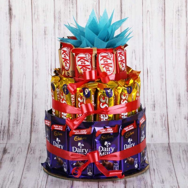 Chocolate Tower arrangement of 12 Cadbury's DairyMilk Chocolates (14gms each), 12 5-Star Chocolates (22gms each) and 10 KitKats (12gms each)