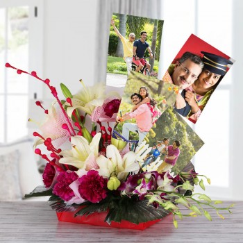 4 White Asiatic Lilies with 10 Dark Pink Carnations and 2 Blue orchids in Net and Paper packing and 4 Personalised Photos