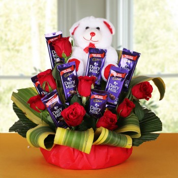 8 Red Roses with 8 Cadbury's DairyMilk Chocolates (14gms each) and Teddy Bear (6 inches) in a Basket
