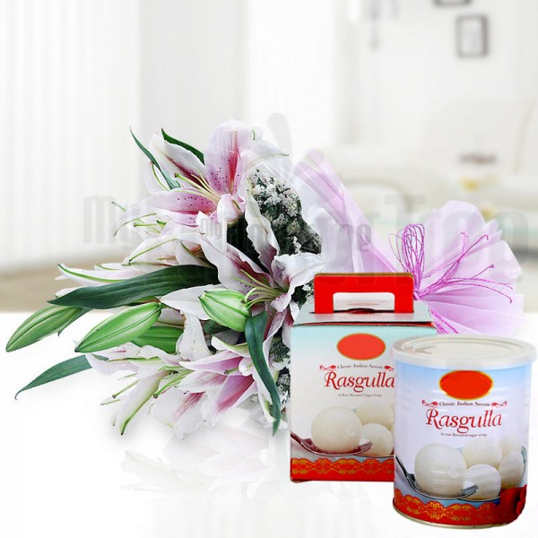 6 Oriental Pink Lilies in Pink and White Paper Packing, Pink Rafia Bow with Rasgullas (1 Kg)
