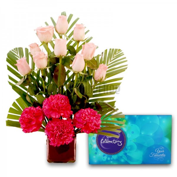 10 Pink Roses and 4 Pink Carnations with Cadbury's Celebrations (131.3 gm) in a Glass Vase