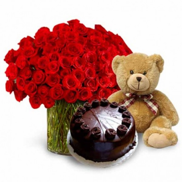 50 Red Roses in a Glass Vase with Teddy (10 inch) and Dark Chocolate Cake (Half Kg)