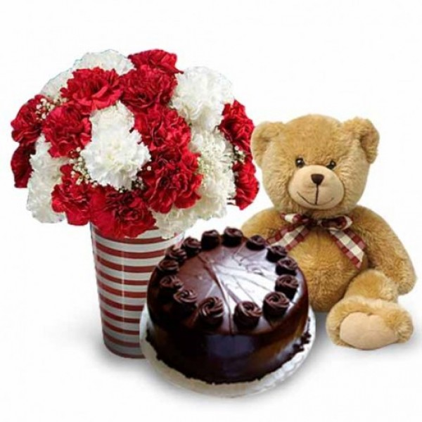 20 Carnations ( Red and White) in a Glass Vase with Teddy (12 inch) and Half Kg Dark Chocolate Cake