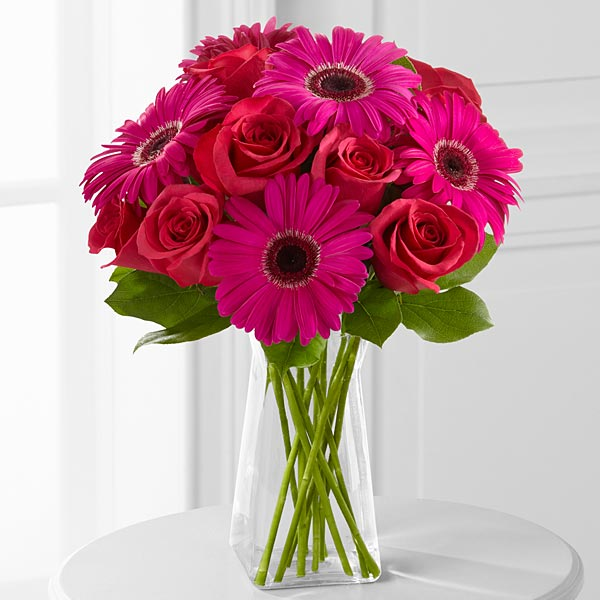 A Bunch of 10 Red Roses and 6 Pink Gerberas in a Glass Vase
