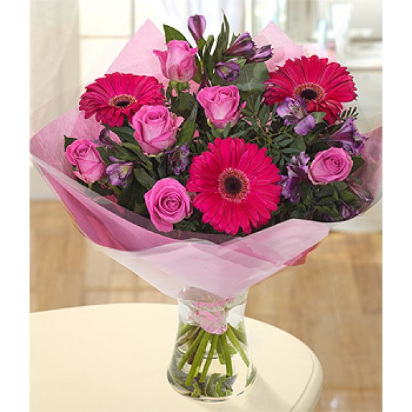 3 Pink Gerberas and 7 Pink Roses wrapped in special Paper