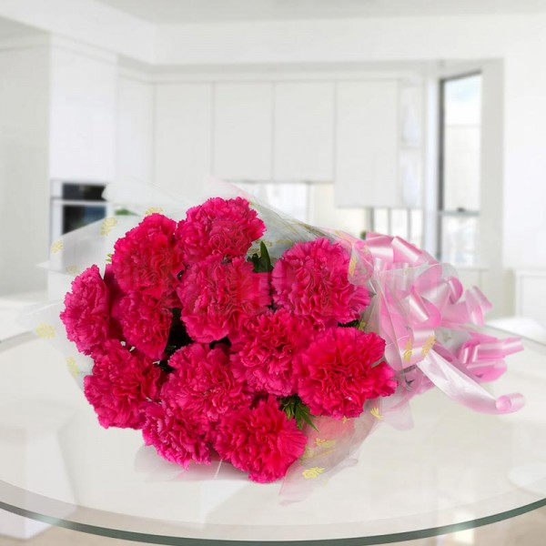 12 Pink Carnations wrapped in cellophane paper