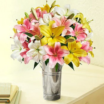 7 Assorted Asiatic Lilies in a Glass Vase