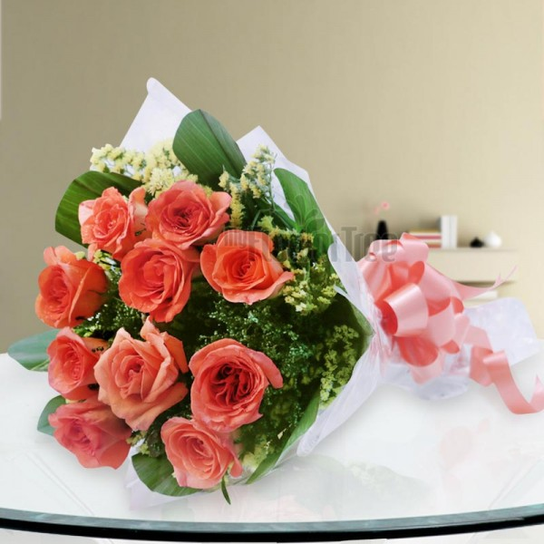 10 Orange Roses wrapped in Cellophane