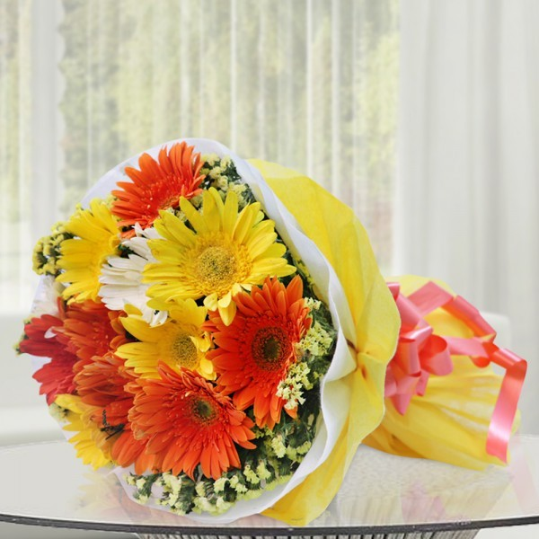 12 Assorted (Orange,Yellow,White) Gerberas wrapped in special Paper