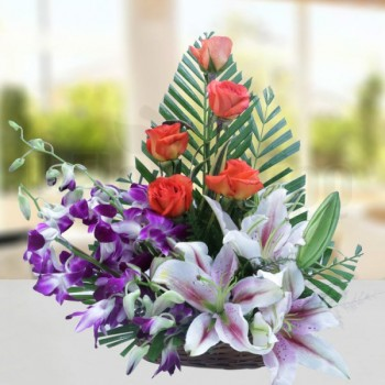 5 Orange Roses and 3 Pink Oriental Lilies and 3 Purple Orchids with Arica Palm Leaves in a Basket