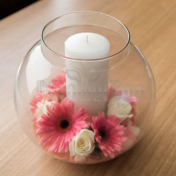 Glass Bowl with 4 Pink Gerberas and 5 White Roses and a White Pillar Candle