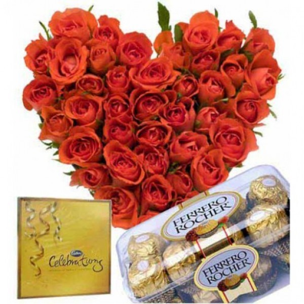 Heart-shaped arrangement of 60 Red Roses with A box of 16 pcs of Ferrero Rocher Chocolates and A box of Cadbury's Celebrations(141.4 gm)