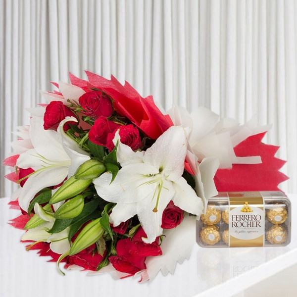 12 Red Roses and 3 White Asiatic Lilies wrapped in crape paper with 16 Pcs Ferrero Rocher