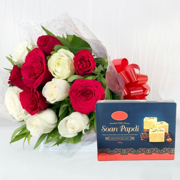12 Red and White Roses in Cellophane Packing with Soan Papdi ( Half Kg)