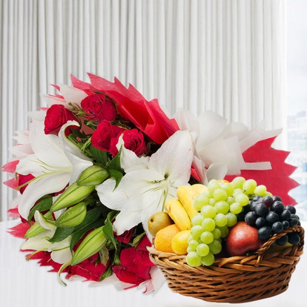 A bunch of Flowers (12 Red Roses, 3 White Asiatic Lily) in Red and White Paper Packing, White Paper Bow with 2 Kg Seasonal Fruits in Basket