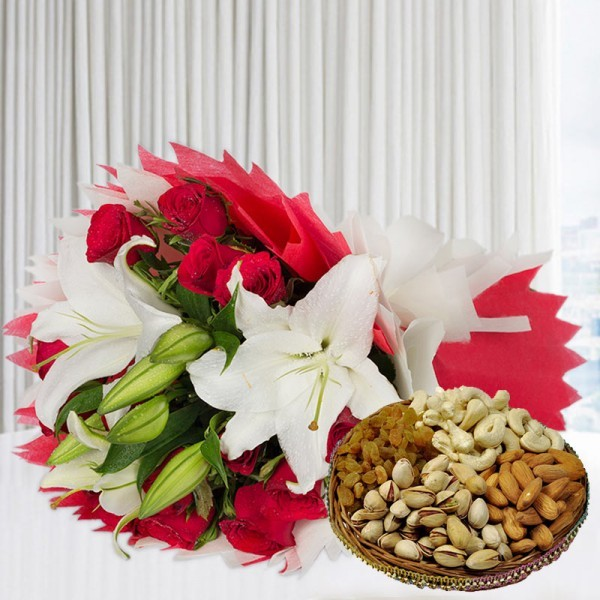 A bunch of Flowers (12 Red Roses, 3 White Asiatic Lily) in Red and White Paper Packing, White Paper Bow with Assorted Dry Fruits (250gms)