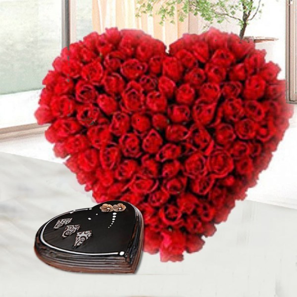 Heart Shape arrangement of 50 Red Roses with 1 Kg Heart Shape Chocolate Cake