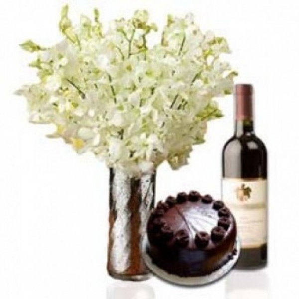 8 White Orchid in a Glass Vase with Half Kg Dark Chocolate Cake and Bottle Of Red Wine