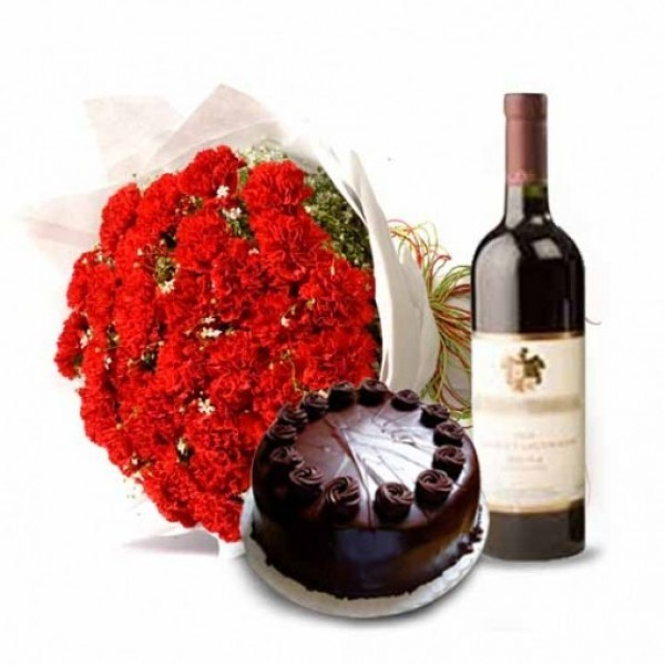 20 Red Carnations in Paper Packing with Half Kg Dark Chocolate Cake and Bottle Of Red Wine