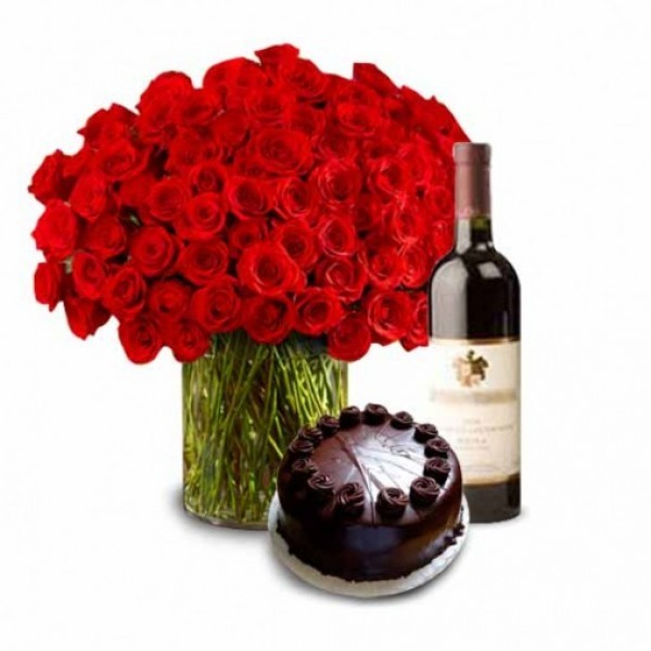 100 Red Roses in a Glass Vase with Half Kg Dark Chocolate Cake and Bottle Of Red Wine