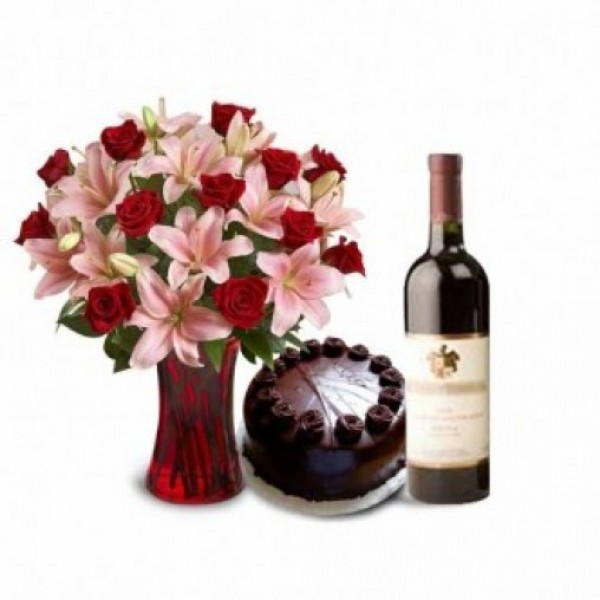 5 Pink Asiatic Lilies and 10 Red Roses with Half Kg Dark Chocolate Cake, Bottle Of Red Wine in a Glass Vase