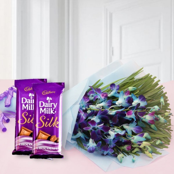 6 Blue Orchids - Blue Paper packing - Purple Bow - 2 Cadbury's DairyMilk Silk (60 gms each)