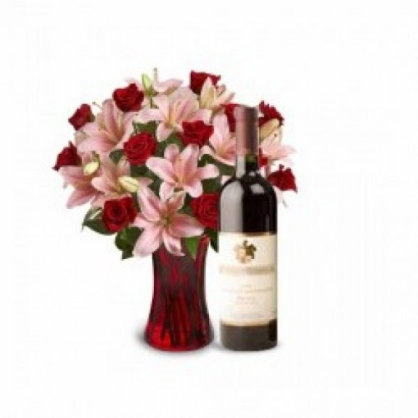 5 Pink Asiatic Lilies and 10 Red Roses in a Glass Vase with Bottle Of Red Wine