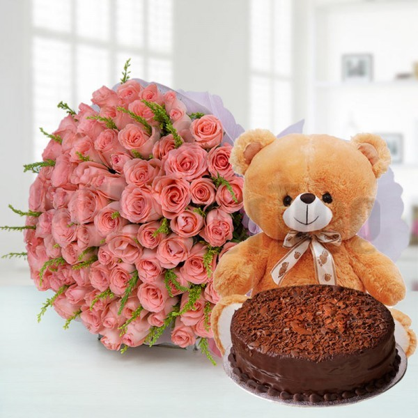 50 Pink Roses in White Paper Packing with Half Kg Chocolate Cake and 1 Teddy Bear (10 inches)