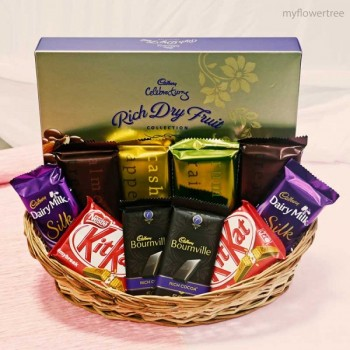 2 Bournville Chocolates (31 Gms Each), 2 Kit Kat Chocolates (37 Gms Each), 2 Dairy Milk Silk ( 60 gm each), 4 Temptation Chocolates (72 Gms Each), 1 Cadbury Rich Dry Fruits (132 Gms) in a Basket