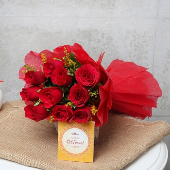 10 Red Roses in Red Paper Packing with One Pack of Roli Tikka