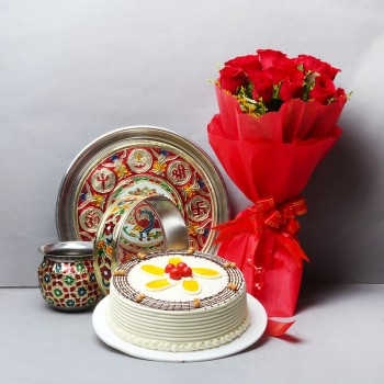 10 Red Roses in Red Paper Packing with Half Kg Butterscotch Cake and One Designer Pooja Thali Set