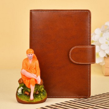 Sai Baba Statue with Notebook