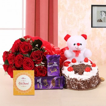 10 Red Roses in Paper Packing with 2 Cadbury's Dairy Milk Silks and Black Forest Cake (Half Kg) also 1 Teddy Bear (6 Inches) and One Pack of Roli Tikka