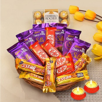 A Chocolate Basket of 5 kitkat (13.2gms each), 5 5star (22.4gms each), 6 DairyMilk silk (60 gms each), 16pcs ferrero rochers (200gms) and Set of 2 Diya for Diwali
