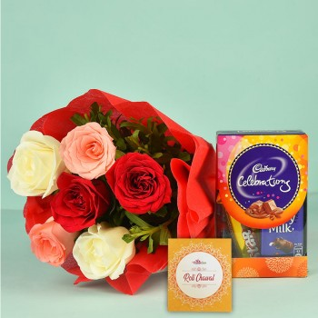 6 Assorted Roses in a paper packing with Celebration Pack (65 gm) and Pack of Roli Chawal
