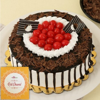 Half Kg Black Forest Cake decorated with Cherries for Bhai Dooj with a Pack of Roli Chawal