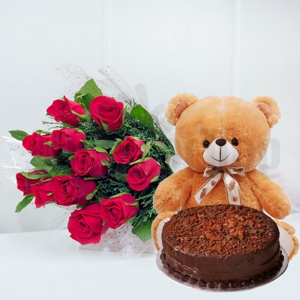 12 Red Roses in Cellophane Packing, Red Bow with Half Kg Chocolate Cake and 1 Teddy Bear (10 inches)