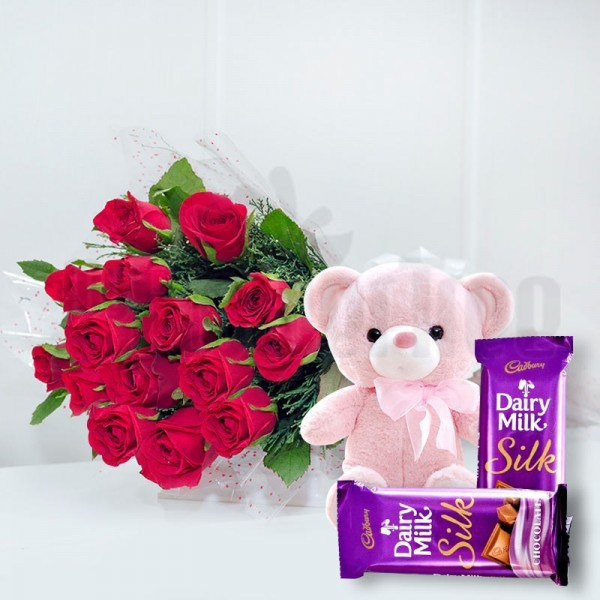 15 Red Roses in Cellophane Packing, Red Bow with 2 Cadbury's DairyMilk Silk (60gms each) and 1 Teddy Bear (6 inches)