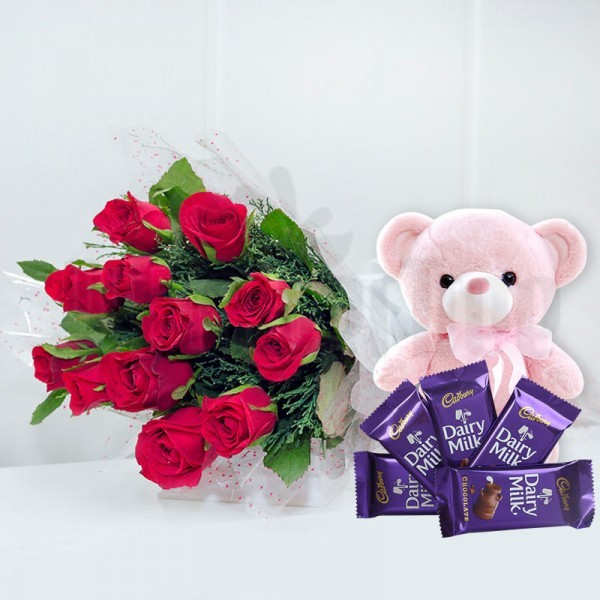 12 Red Roses in Cellophane Packing, Red Bow with 5 Cadbury's DairyMilk Chocolates (13 gms each) and 1 Teddy Bear (6 inches)
