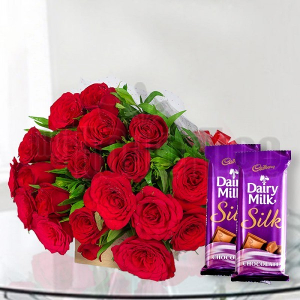 18 Red Roses in Cellophane Packing, Red Bow with 2 Cadbury's DairyMilk Silk (60 gms each)