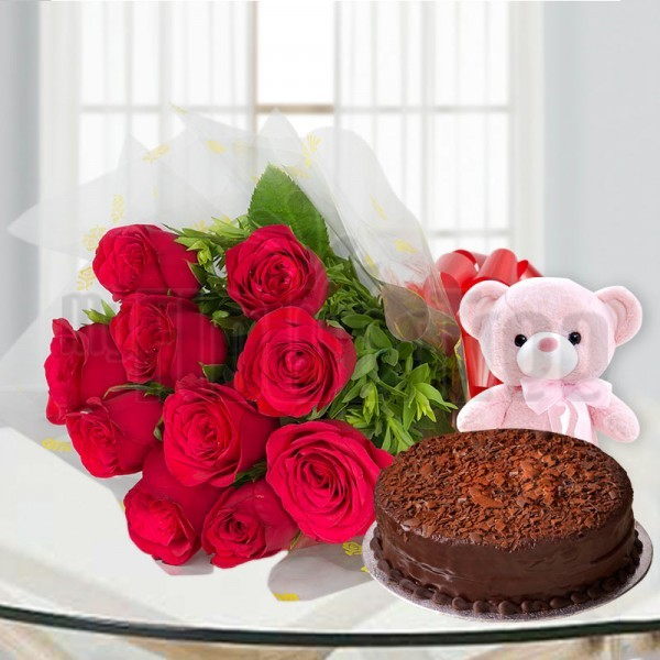 10 Red Roses in Cellophane Packing, Red Bow with Half Kg Chocolate Cake and 1 Teddy Bear (6 inches)
