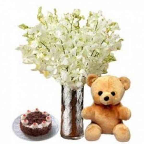 8 White Orchids in a Glass Vase with Teddy bear (6 inches) and Blackforest Cake (Half kg)