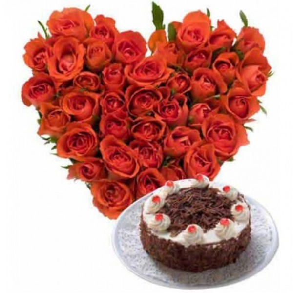 Heart-shaped arrangement of 50 Red Roses with Half Kg Black Forest Cake